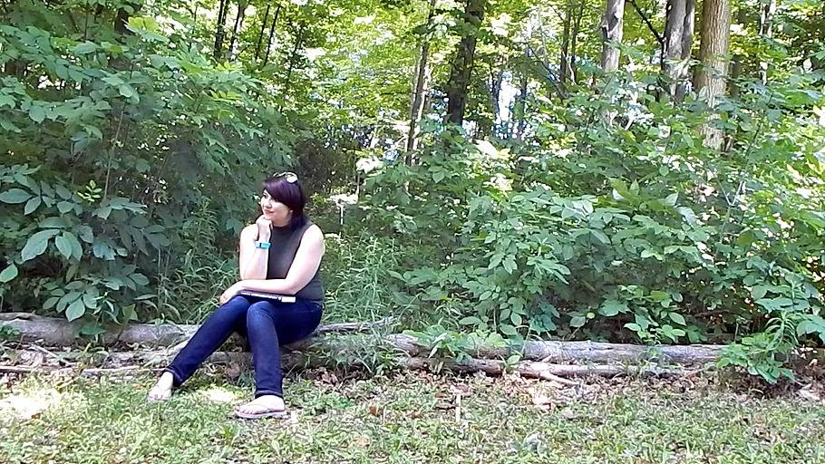 sitting in the woods log self